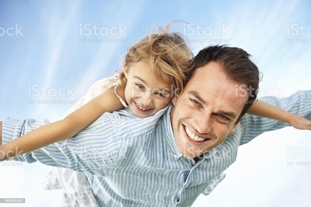 Man giving piggyback ride to daughter royalty-free stock photo