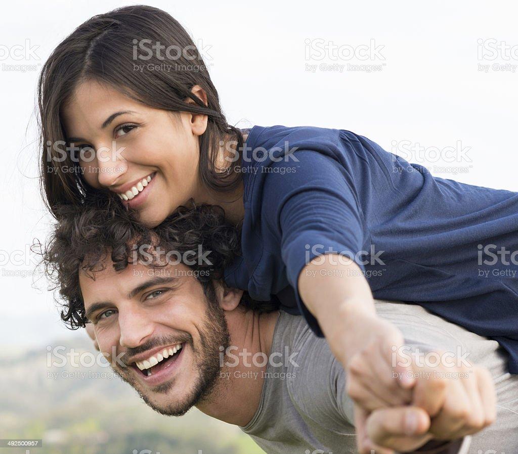 Man Giving Piggyback Ride To Woman stock photo