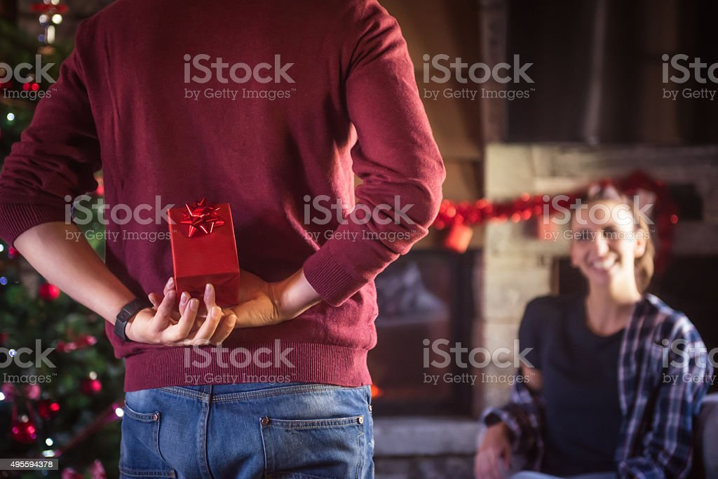 Man giving present to girlfriend stock photo