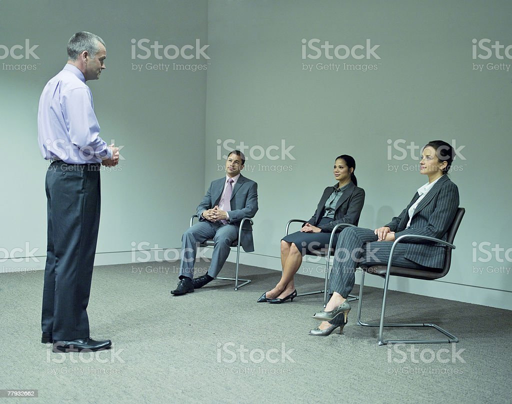 Man giving presentation to three co-workers royalty-free stock photo