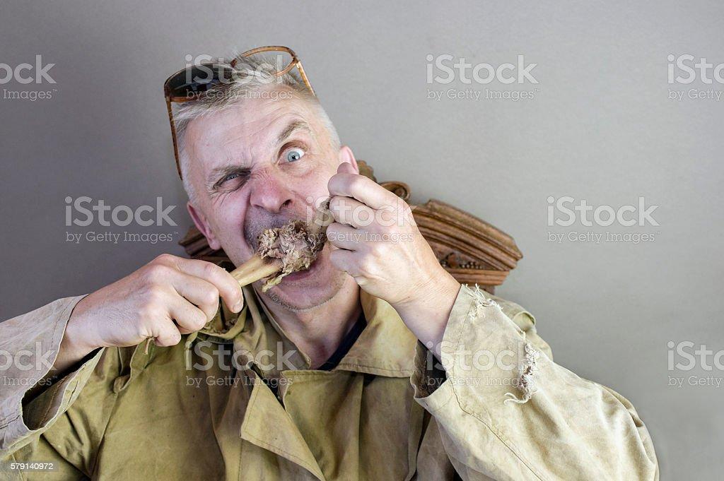 Man Gnawing A Bone stock photo