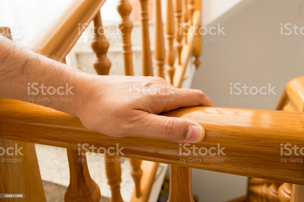 man go downstairs at home stock photo