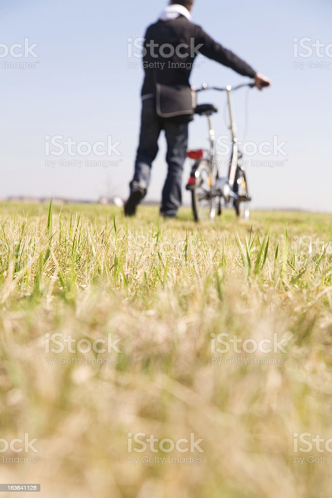 Man goes away with bicycle royalty-free stock photo