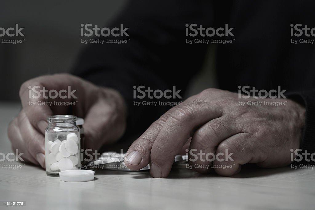 Man going to overdose drugs stock photo