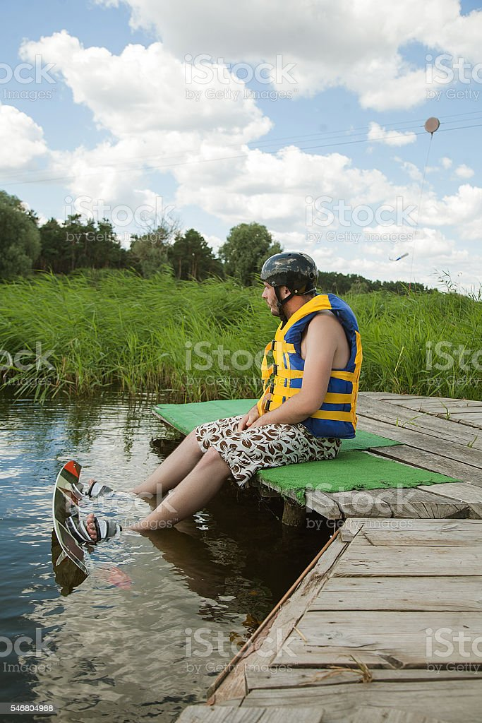 Man going to  Wakeboarding stock photo