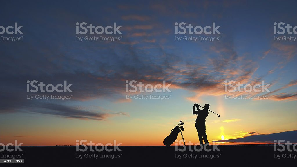 man golf player hit ball to air silhouetted royalty-free stock photo