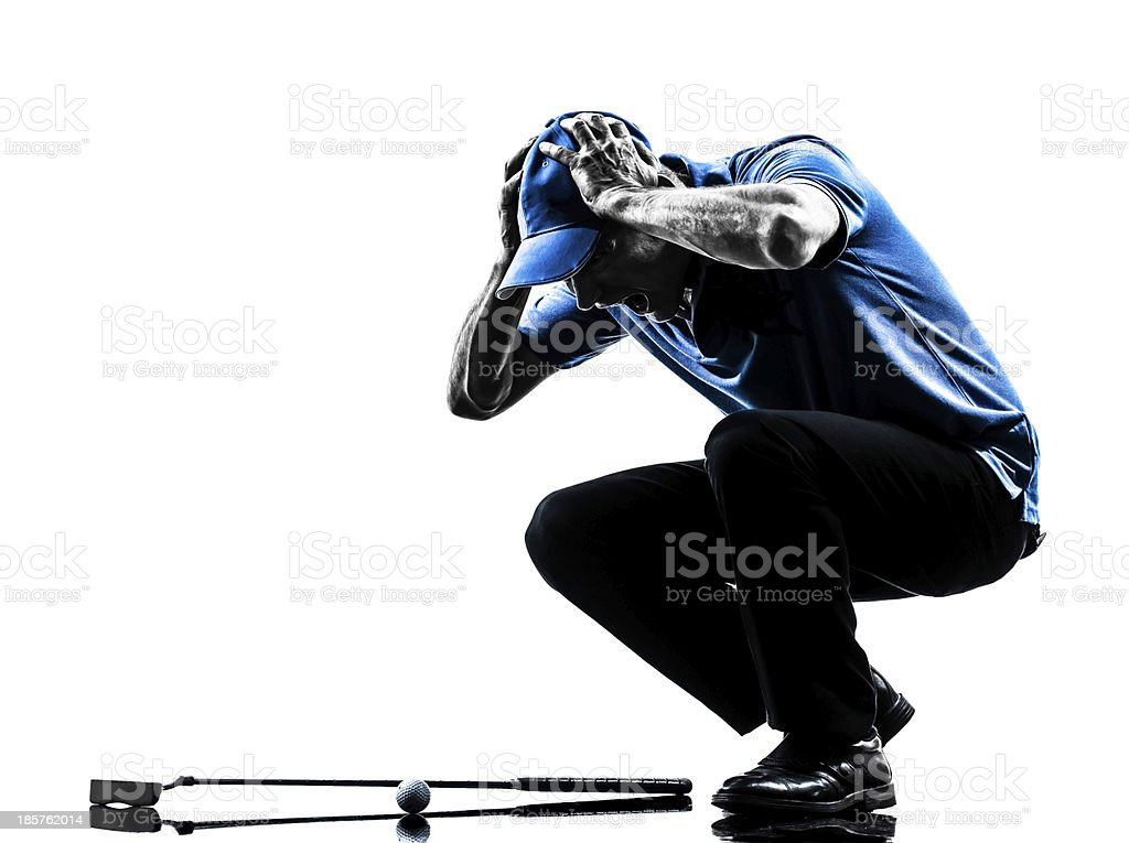 man golfer golfing head in hands silhouette stock photo