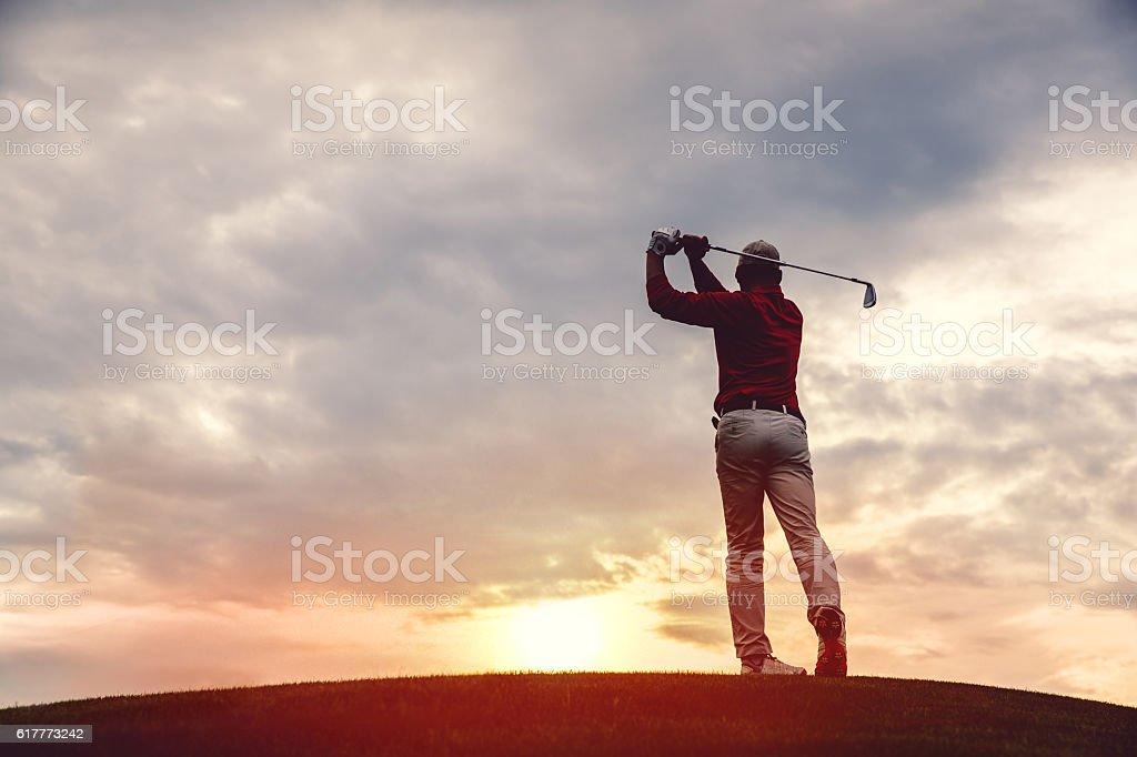 man golfer silhouette stock photo