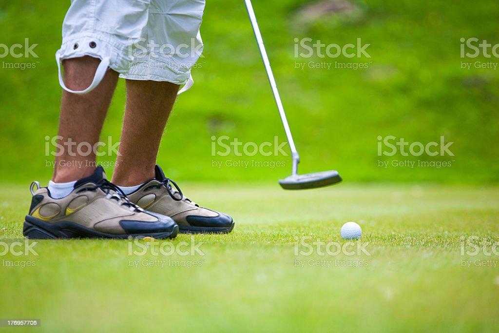 Man golfing stock photo
