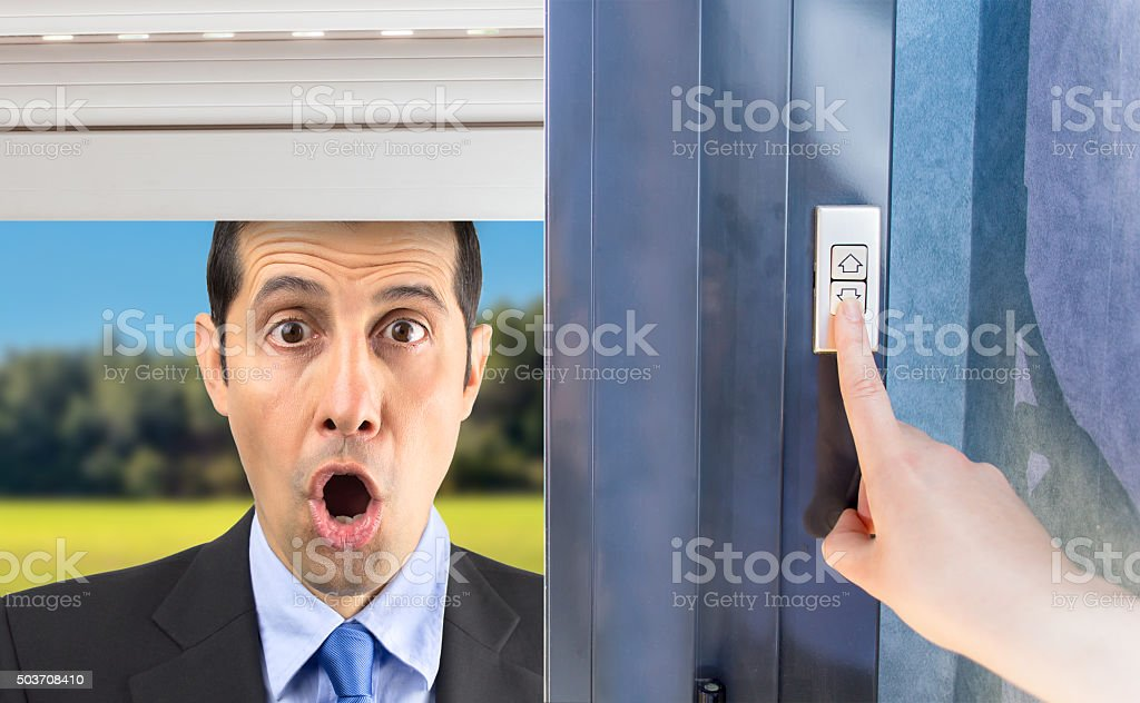man gossiping through the window stock photo