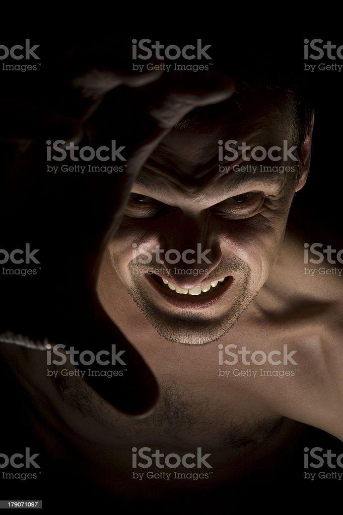 Man grabbing towards the viewer royalty-free stock photo