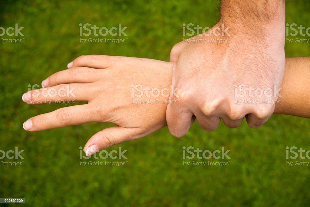 Man grabbing woman's wrist. stock photo