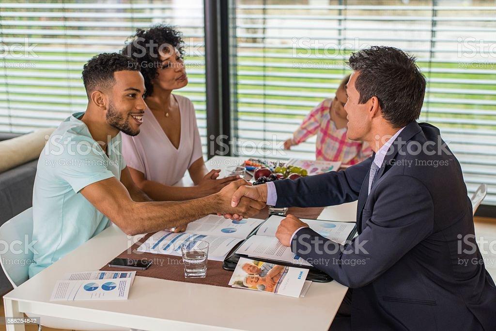 Man greeting male financial advisor stock photo