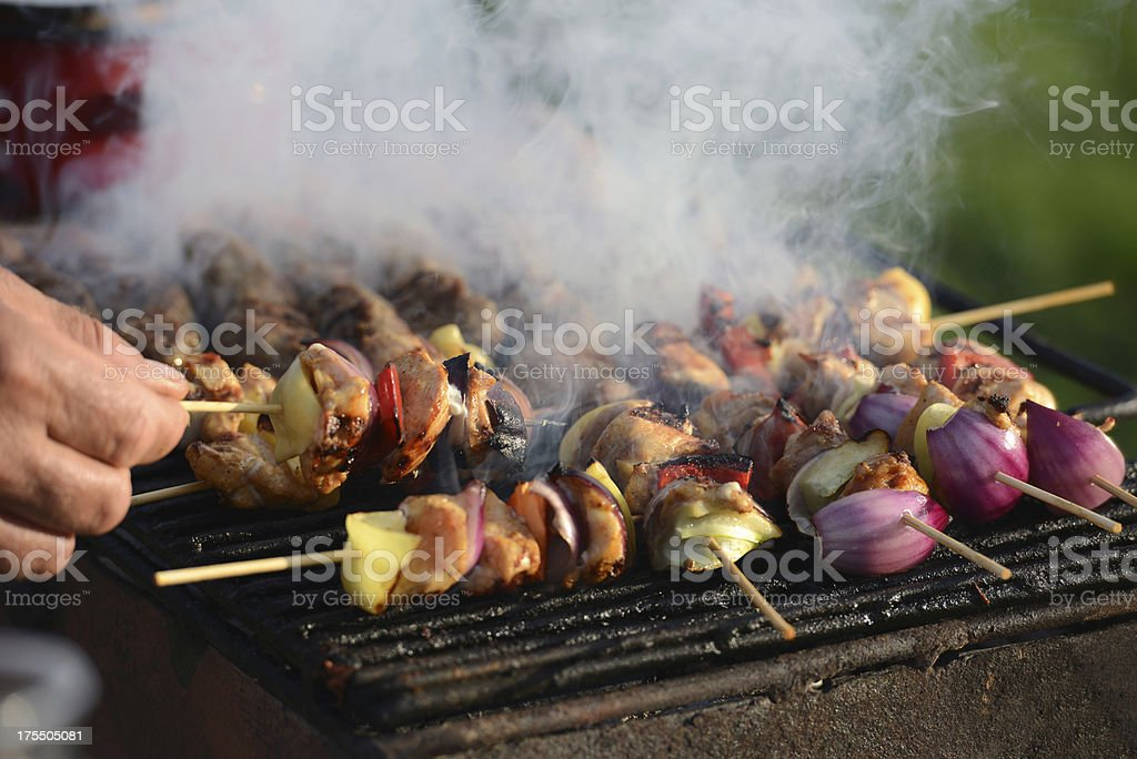 Man Grilling Barbecue for Party stock photo