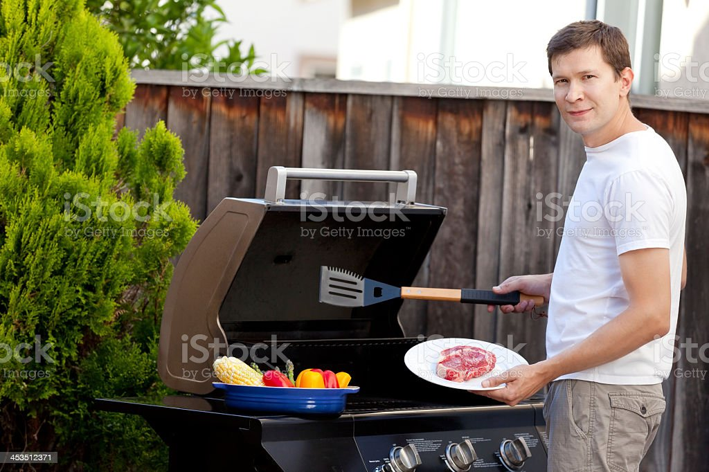 Man grilling barbecue items on a griller royalty-free stock photo