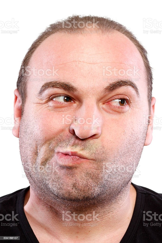 Man grimacing stock photo