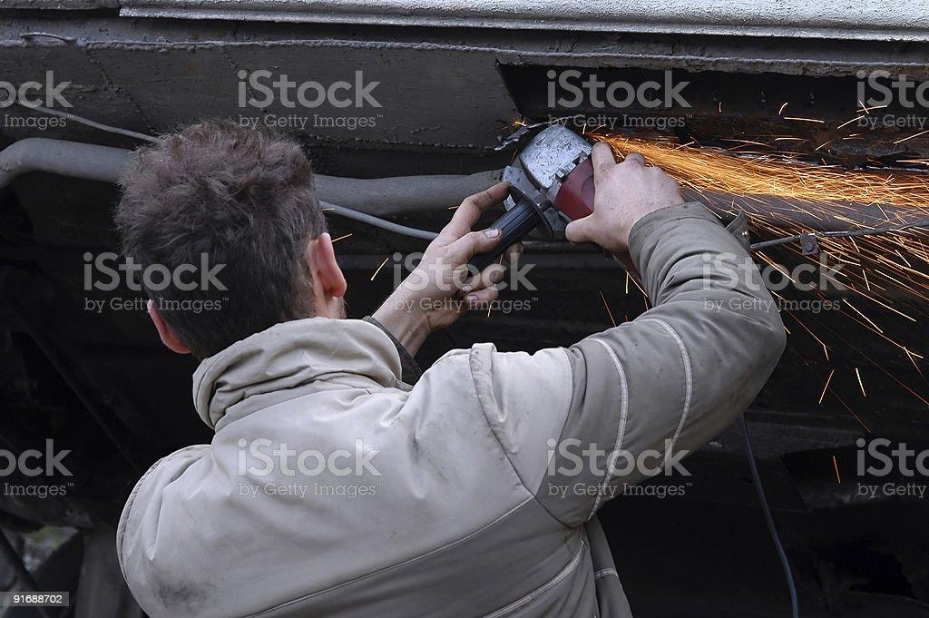 Man grinding his car stock photo