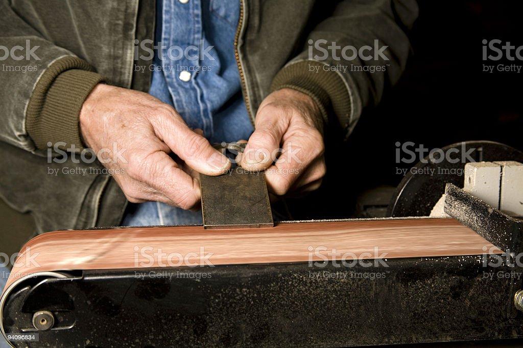 Man grinding in workshop royalty-free stock photo