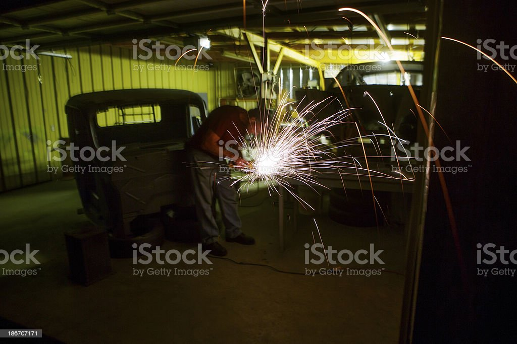 Man Grinding Metal in Shop royalty-free stock photo