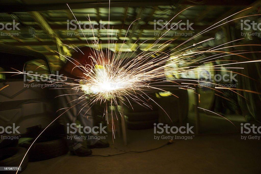 Man Grinding Metal in Shop royalty-free stock photo