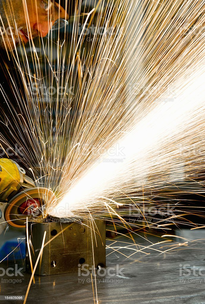 Man grinding metal royalty-free stock photo