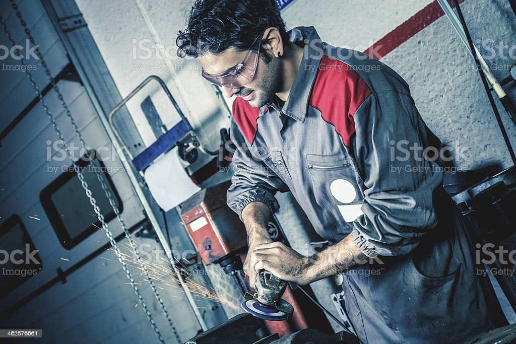 Man grinding metal stock photo
