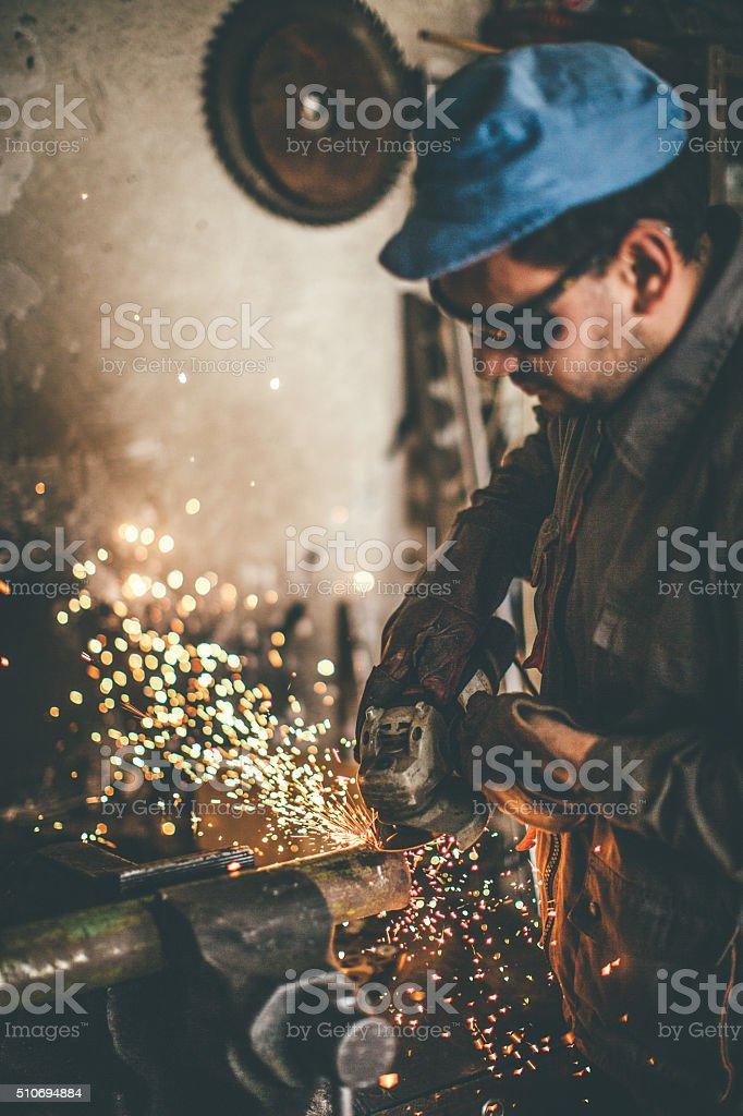 Man grinding metal stock photo