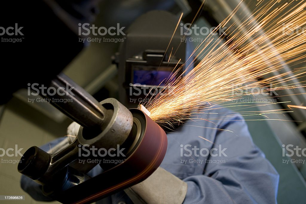 Man Grinds Metal royalty-free stock photo