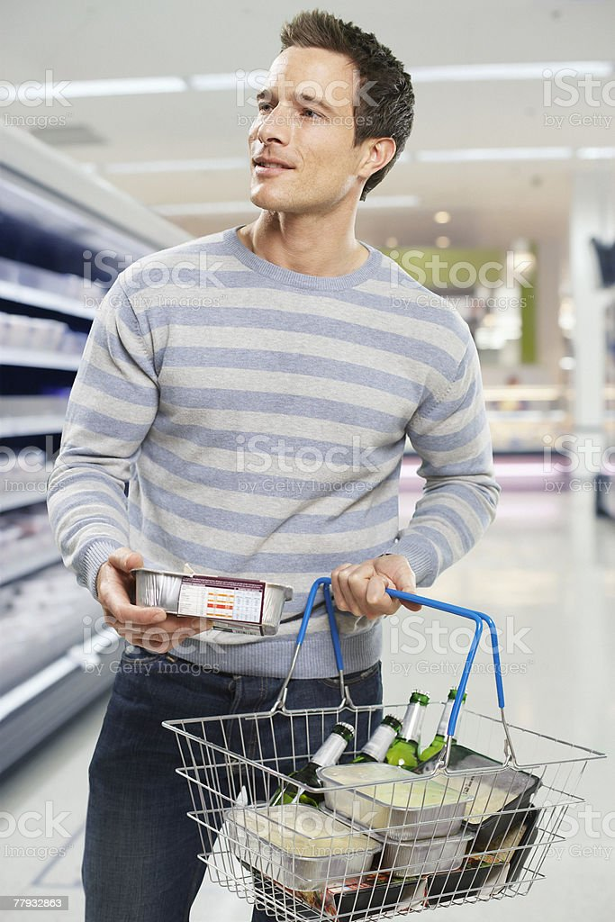 Man grocery shopping stock photo