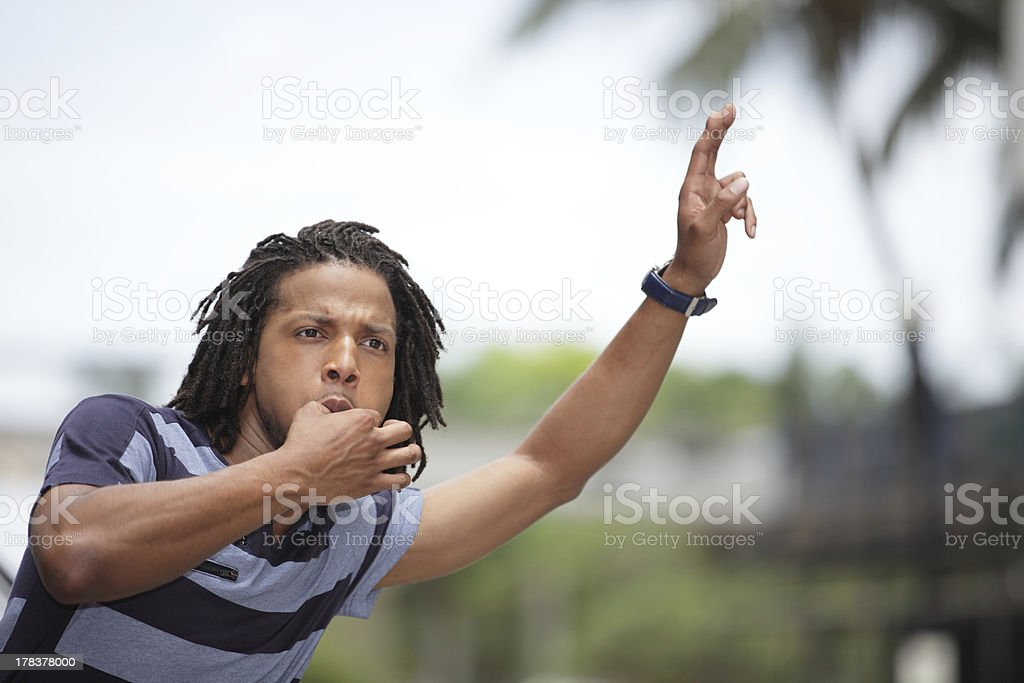 Man hailing a cab stock photo