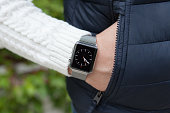 Man hand and Apple Watch with time on the screen