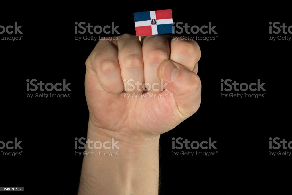 Man hand fist with Dominican Republic flag isolated stock photo