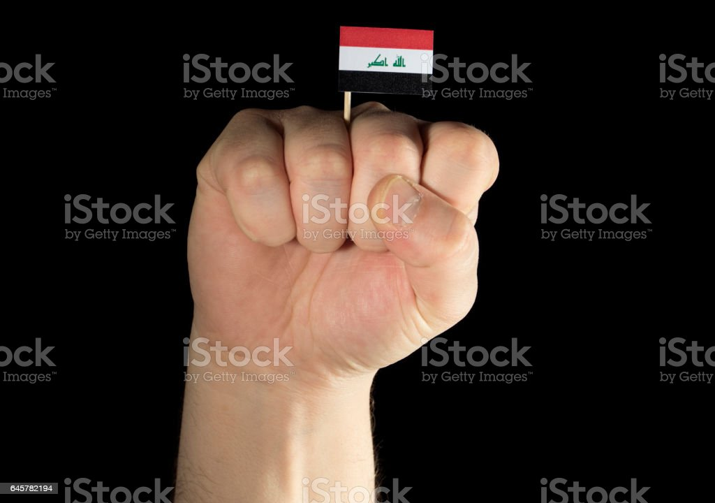 Man hand fist with Iraqi flag isolated on black background stock photo