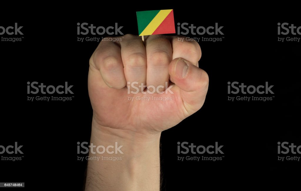 Man hand fist with Republic of Congo flag isolated stock photo