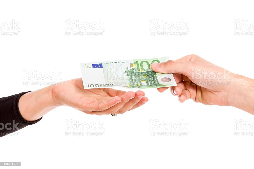 man hand giving 100 euro to woman hand stock photo