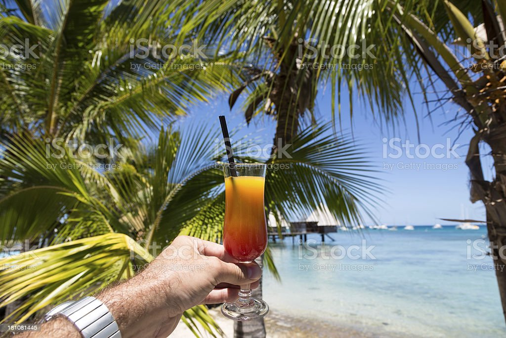 Man Hand Holding a Coktail at Tropical Beach Resort royalty-free stock photo
