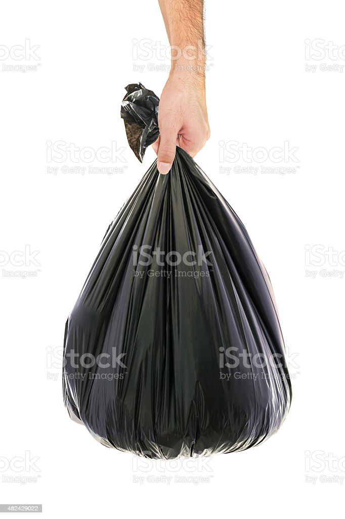 man hand holding a garbage bag stock photo
