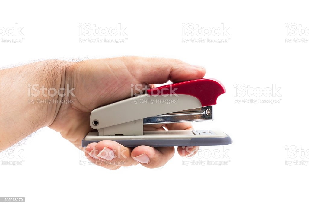 man hand holding a stapler isolated on a white background stock photo