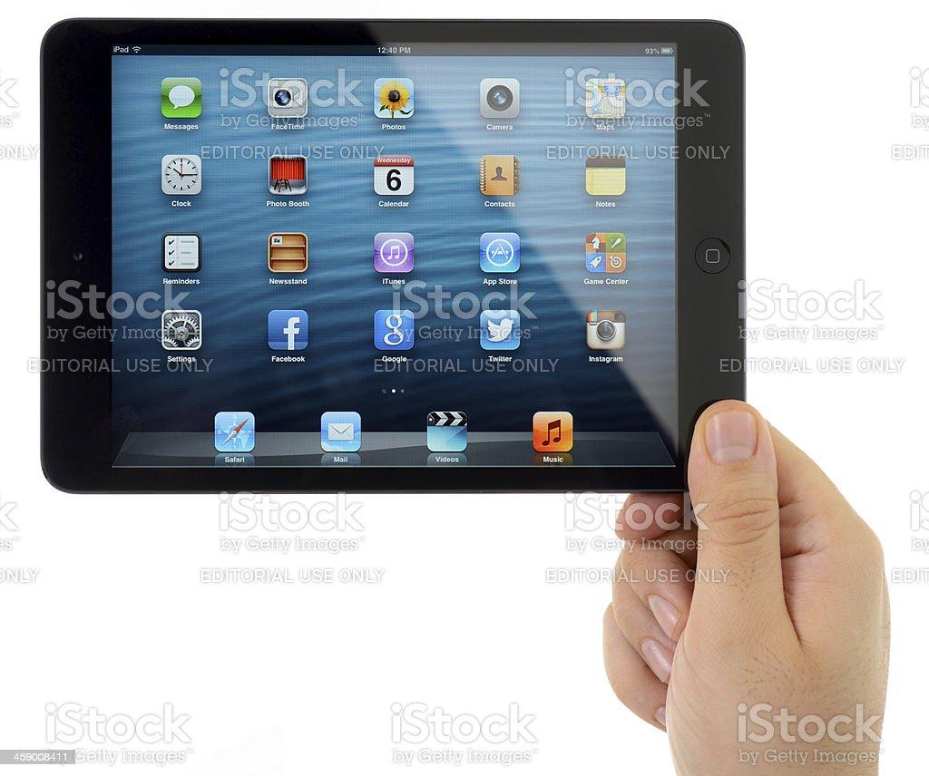 Man hand holding black iPad Mini royalty-free stock photo