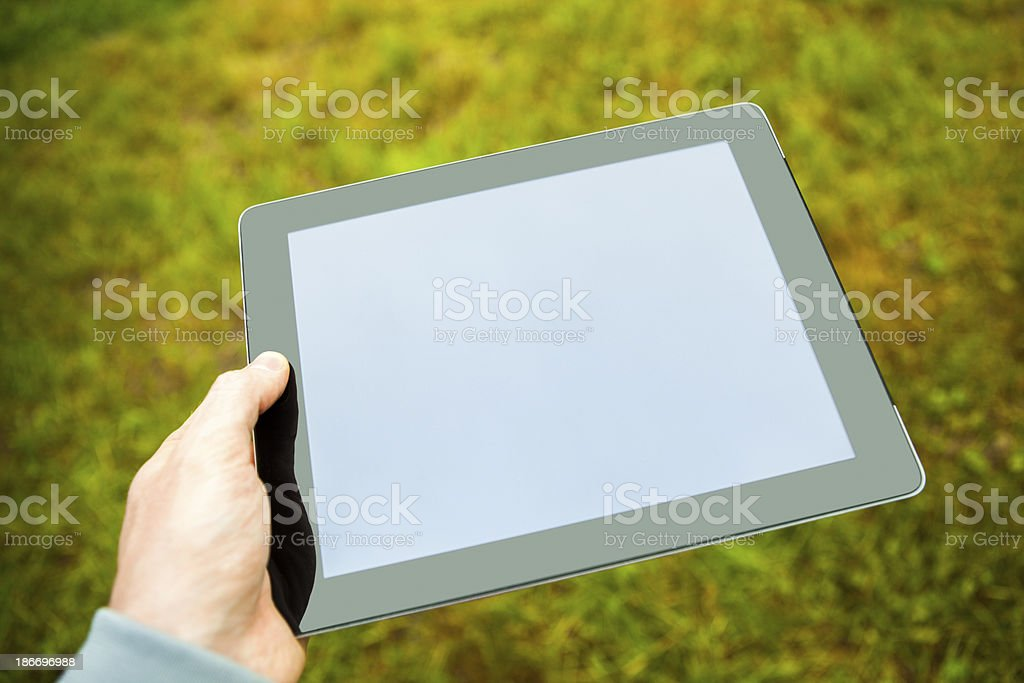 Man hand holding digital tablet royalty-free stock photo