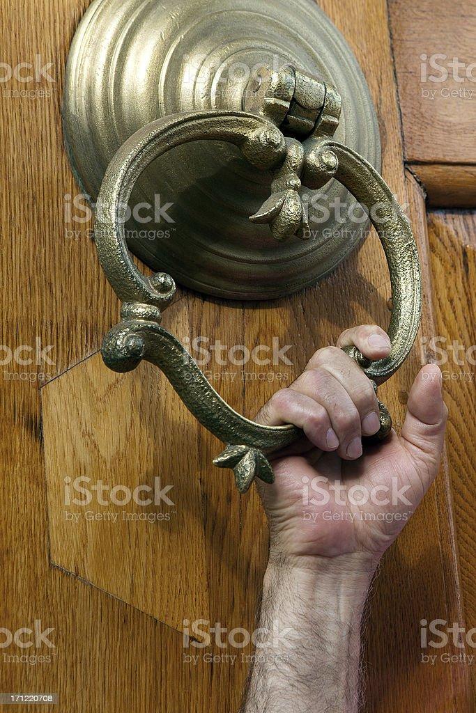 Man hand holding door handle royalty-free stock photo