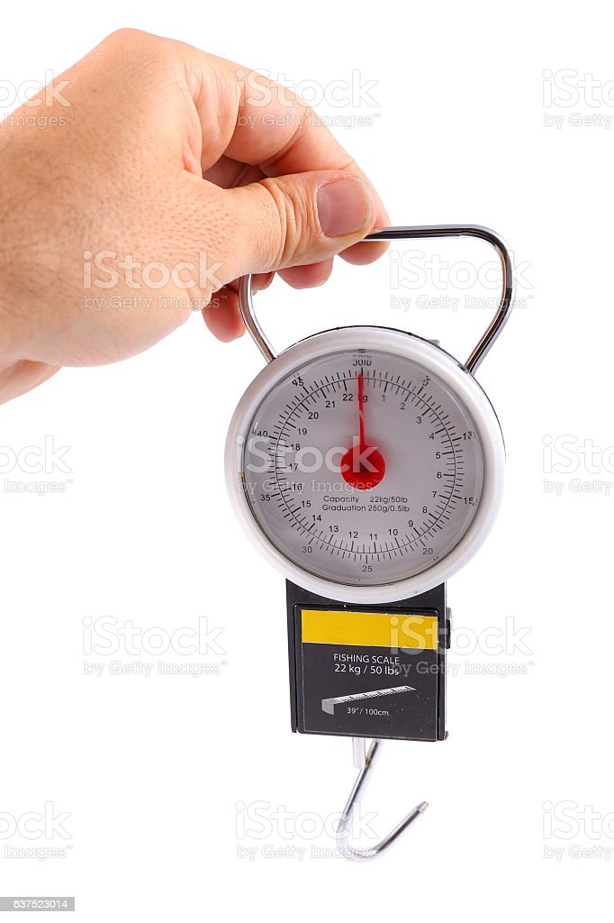 man hand holding fishing scale stock photo