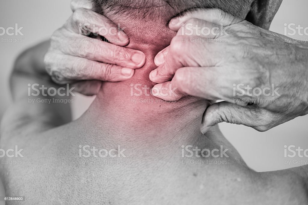 man hand holding he neck and massaging in pain area stock photo