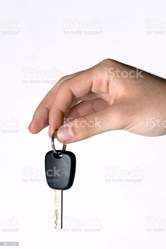 Man hand holding key, close-up royalty-free stock photo