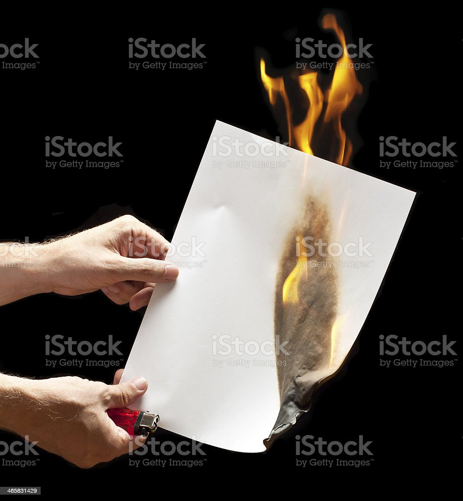 Man hand holding lighter and white burned paper stock photo