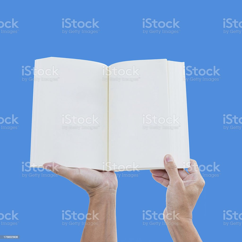 Man hand holding open book on blue screen royalty-free stock photo