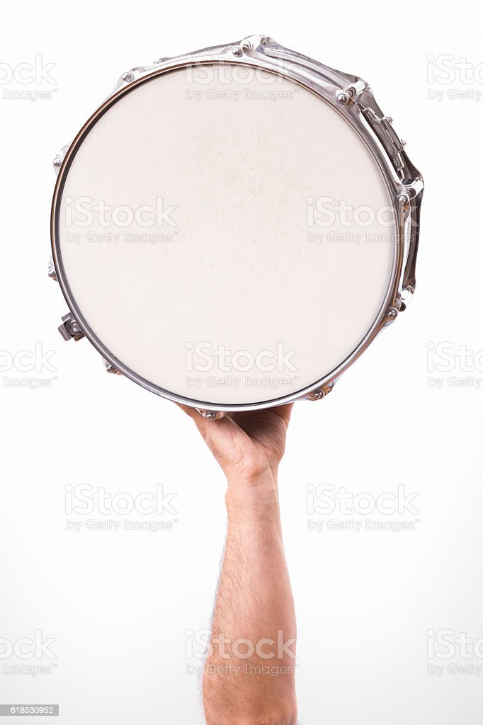 man hand holding snare drum high up stock photo