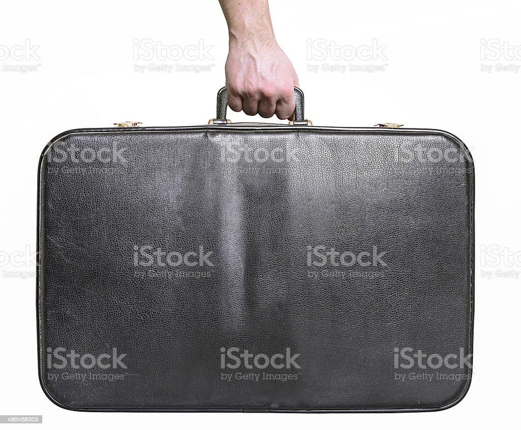 Man hand holding vintage leather travel bag stock photo