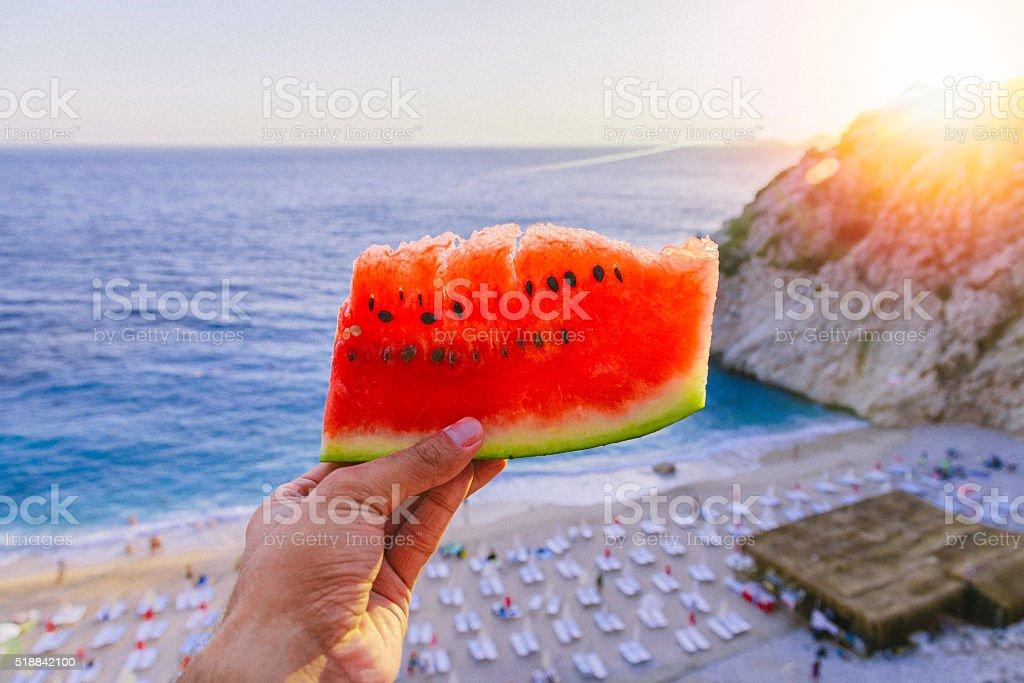 Man hand holding watermelon stock photo