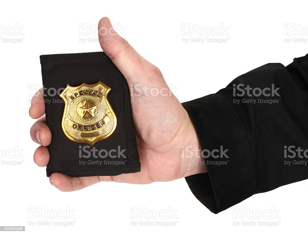 Man hand is holding golden special officer badge stock photo